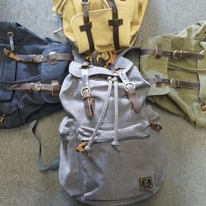 100 % cotton backpack with leather attachments